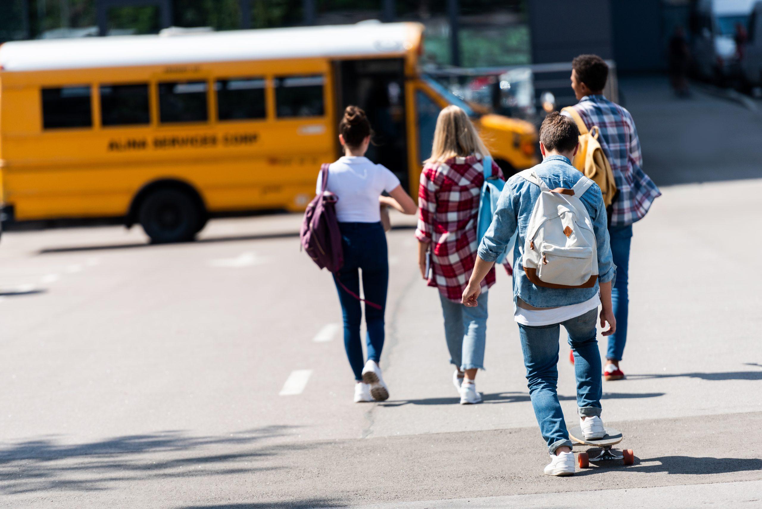 kids going on school bus