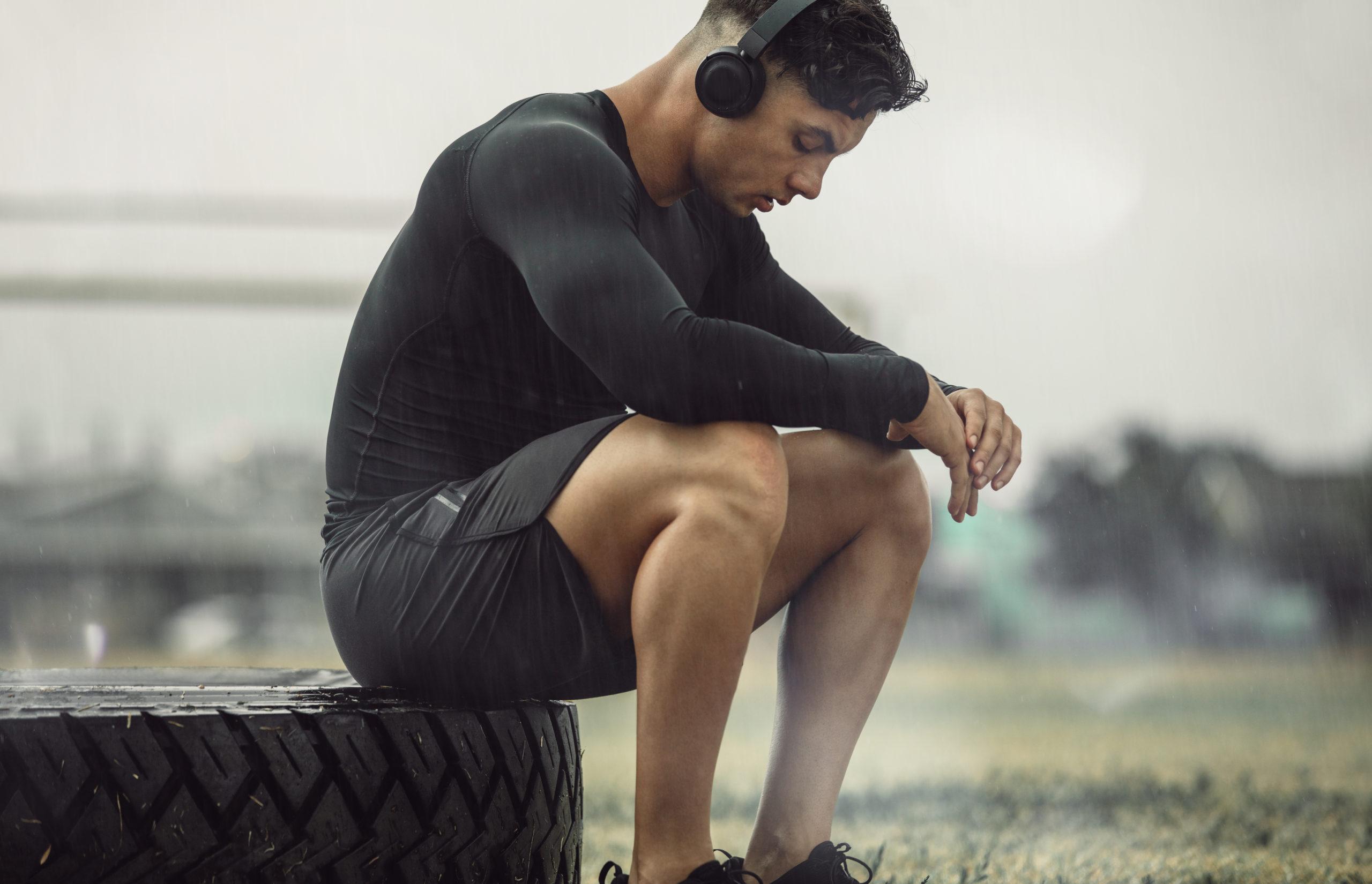 athlete sitting down in park