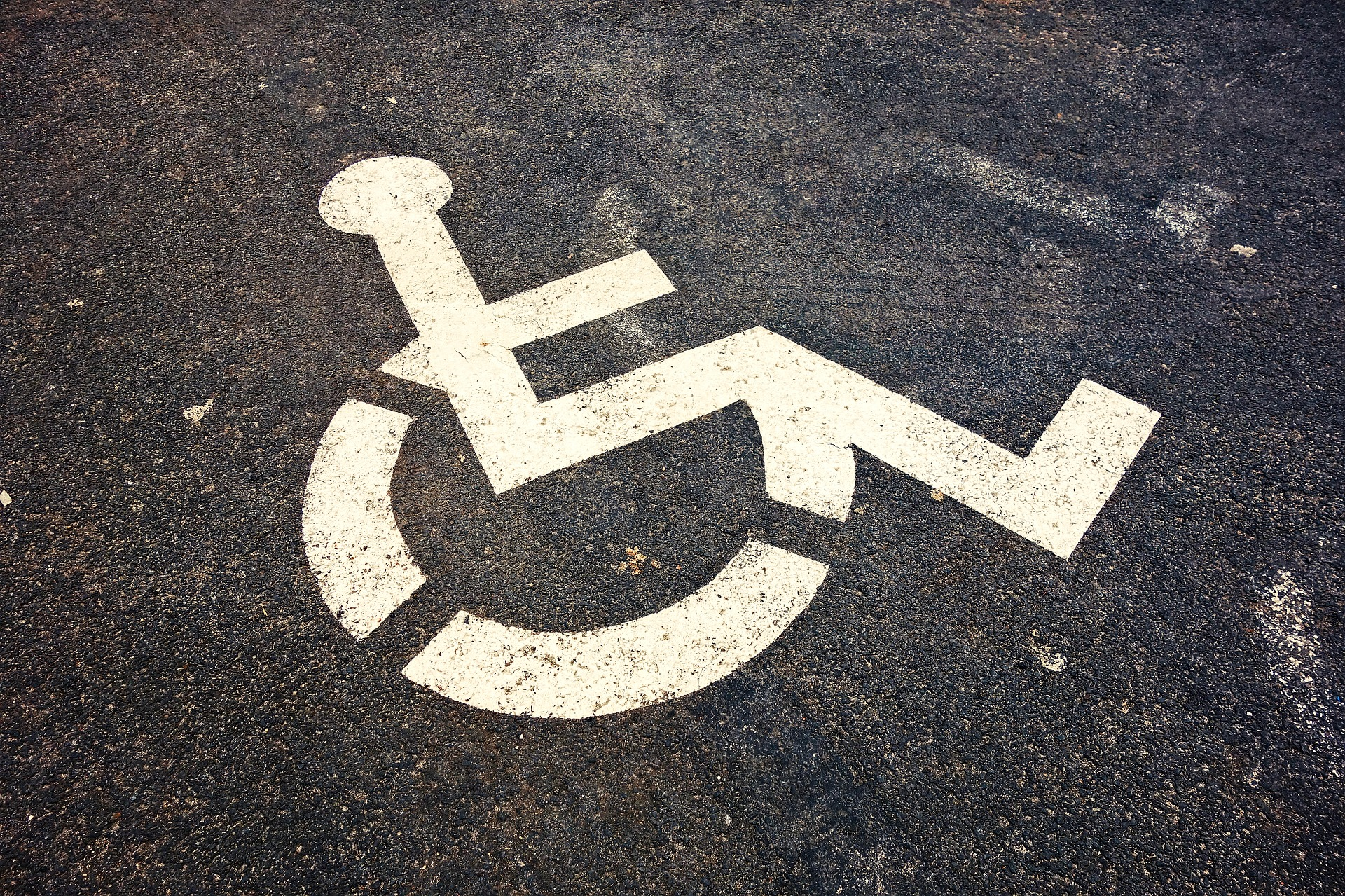 Wheelchair symbol painted on the ground