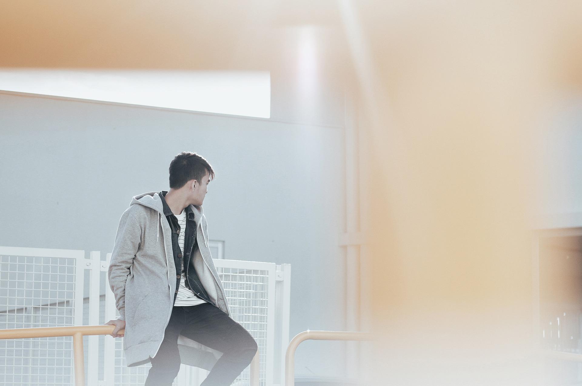 Teenager sitting on a railing