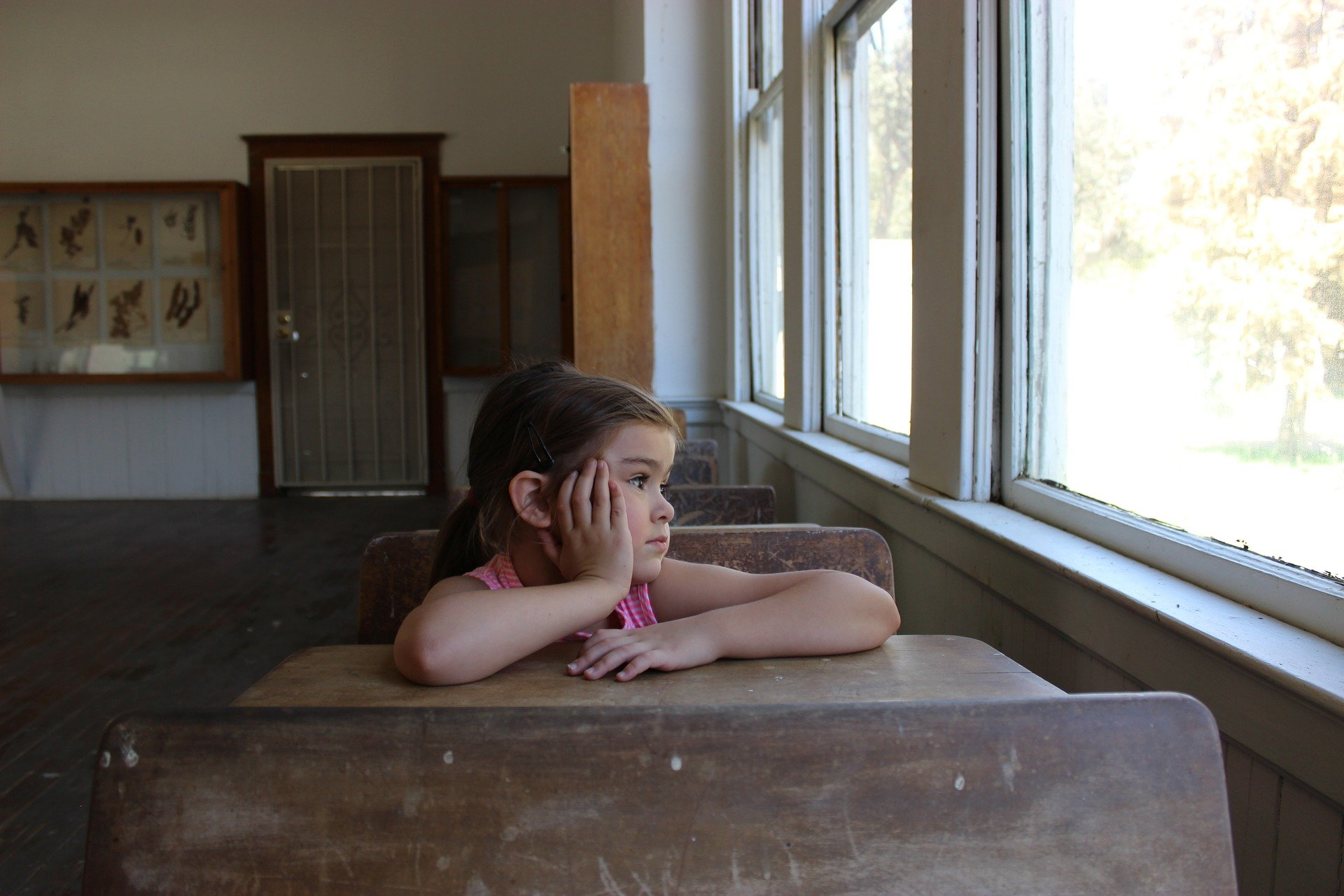 A girl staring out a school window